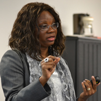 Photo by Stan Niu: Professor Odedina presents the inaugural lecture of the Congressionally Directed Medical Research Programs at Fort Detrick, MD.