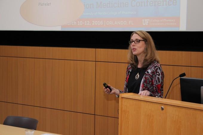 Dr. Larisa Cavallari leads a session on pharmacogenomics.