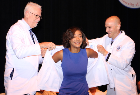 Student receives her white coat