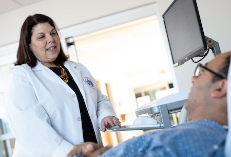 Rhonda Cooper-DeHoff treats a patient