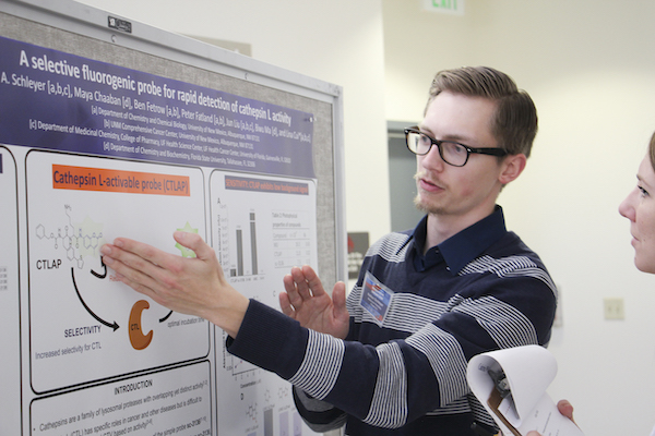Graduate student presents poster at research showcase
