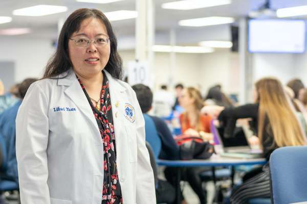 Lihui Yuan, Pharm.D., Ph.D., poses in the MDL classroom