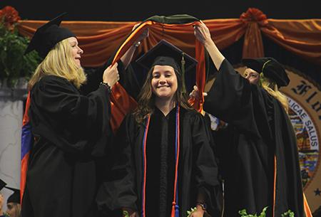 Student receives graduation lanyard