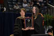 Theresa Tolle received the 2019 UF College of Pharmacy Outstanding Pharmacy Alumnus Award and served as the commencement speaker.