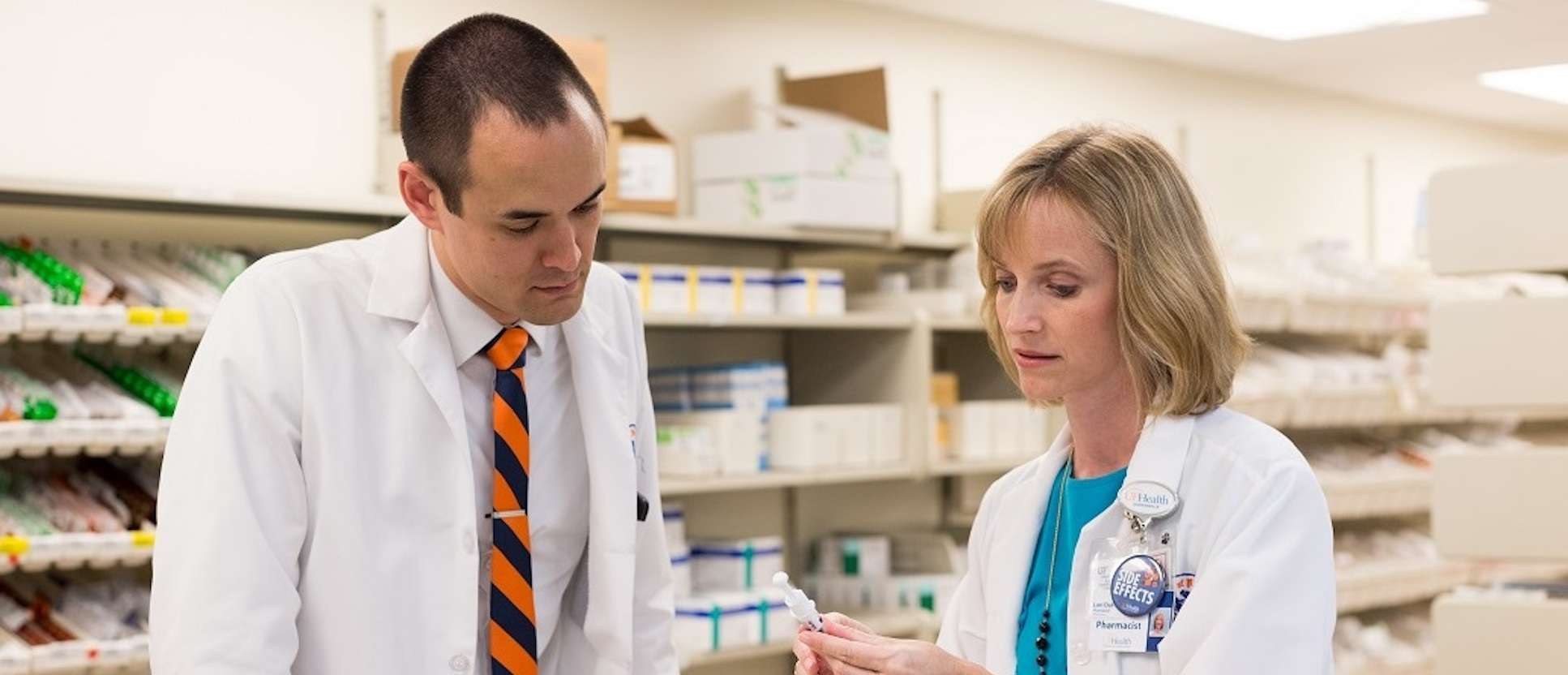 College of Pharmacy student working with an instructor in the UF Health pharmacy.