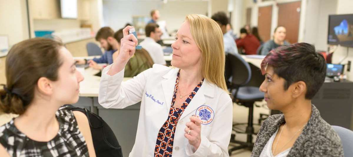 Stacey Curtis, Pharm.D., shows students the proper way to use an inhaler.